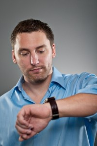 network marketer checking his watch
